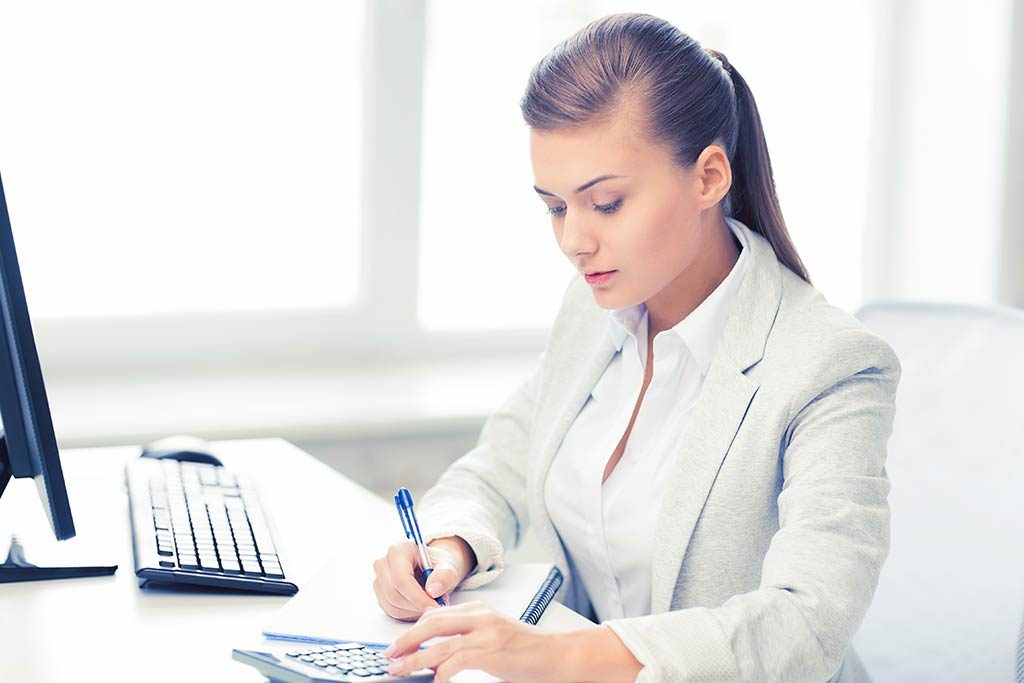 A new dental practice owner doing bookkeeping