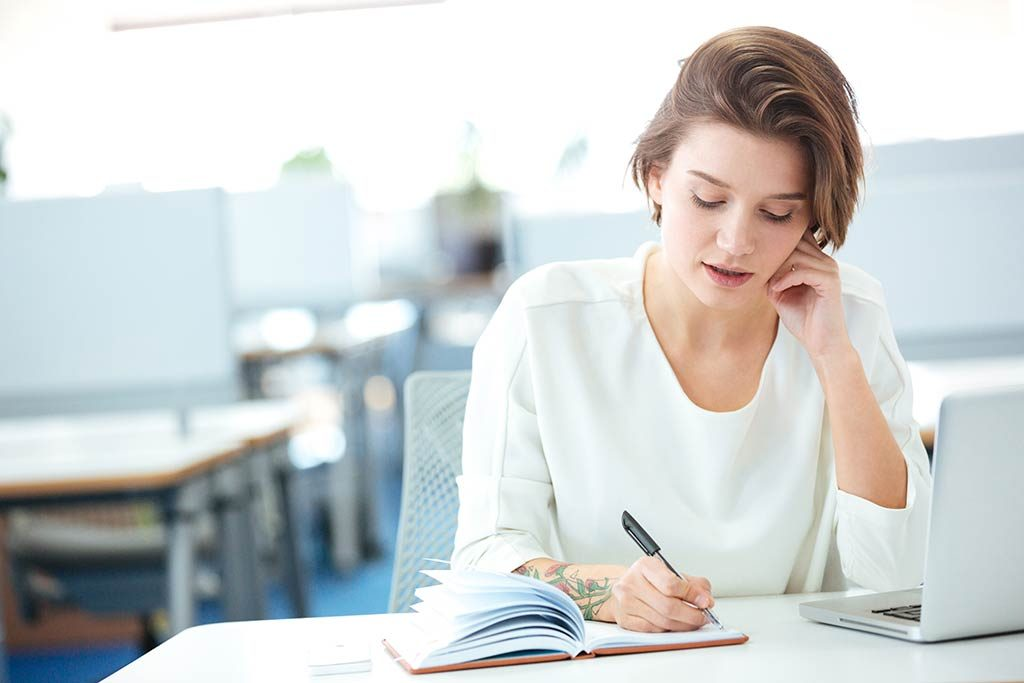 Bookkeeping services header image showing a young businesswoman at work