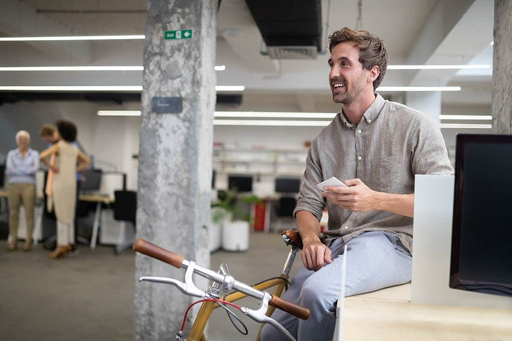 Man in office who has found success through business coaching